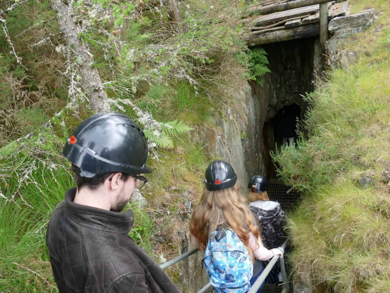 Visitors entering tunnel at Silver Mountain Experience